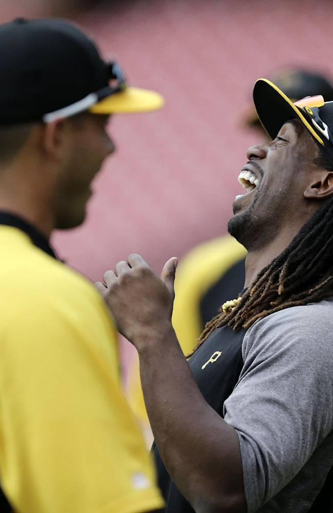 Pittsburgh Pirates center fielder Andrew McCutchen, right, laughs with teammates during a workout on Wednesday, Oct. 2, 2013, in St. Louis. Game 1 of the National League Division Series baseball playoff between the Pirates and the St. Louis Cardinals is scheduled for Thursday