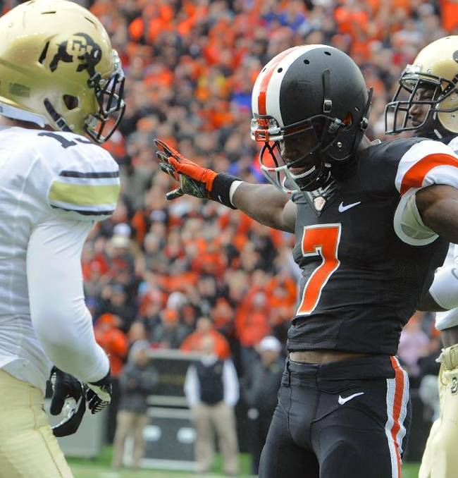 Oregon State's Brandin Cooks (7) celebrates his catch against Colorado's Kenneth Crawley (2) and Parker Orms (13) in the first half of an NCAA college football game on Saturday, Sept 28, 2013, in Corvallis, Ore