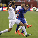 Manchester United's Wayne Rooney, center, battles for the ball against Inter Milan's Andrea Ranocchia, left, and Danilo D'Ambrosio during the first half of a soccer game at the 2014 Guinness International Champions Cup, Tuesday, July 29, 2014, in Landove