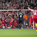 Liverpool's Raheem Sterling, centre left, celebrates after scoring against Southampton during their English Premier League soccer match at Anfield Stadium, Liverpool, England, Sunday Aug. 17, 2014
