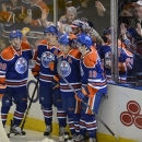 Edmonton Oilers' Sam Gagner, Taylor Hall, Jordan Eberle and Justin Schultz celebrate a goal by Eberle against the Vancouver C