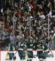 Minnesota Wild defenseman Ryan Suter (20), center Mikko Koivu (9), of Finland, center Charlie Coyle, center, right wing Jason Pominville (29) and left wing Zach Parise (11) celebrate Coyle's goal off Colorado Avalanche goalie Semyon Varlamov during the second period of Game 4 of an NHL hockey first-round playoff series in St. Paul, Minn., Thursday, April 24, 2014. The Wild won 2-1. (AP Photo/Ann Heisenfelt)