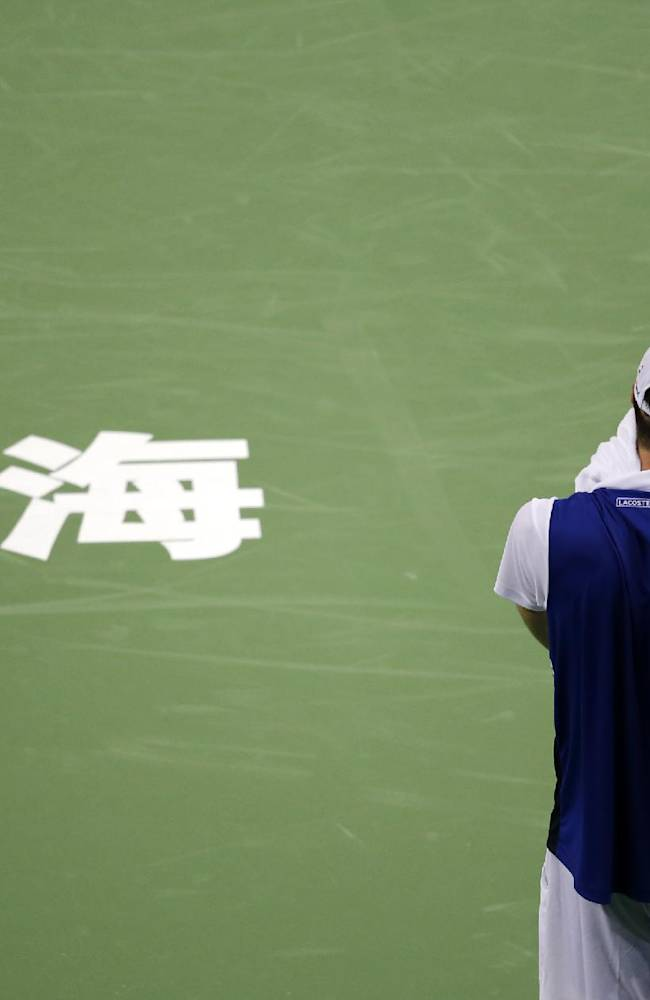 John Isner of the United States pauses during the first round against Santiago Giraldo of Colombia at the Shanghai Masters tennis tournament at Qizhong Forest Sports City Tennis Center, in Shanghai, China, Monday, Oct. 7, 2013. Isner won 4-6, 7-5 7-5