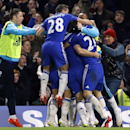 Chelsea's Branislav Ivanovic is congratulated by teammates after scoring during the English League Cup semifinal second leg soccer match between Chelsea and Liverpool at Stamford Bridge stadium in London, Tuesday, Jan. 27, 2015
