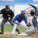 Tampa Bay Rays' Wil Myers, right, is tagged out by Toronto Blue Jays shortstop Jose Reyes, center, while trying to advance to second base on a hit during the fourth inning of an exhibition baseball game Friday, March 7, 2014, in Dunedin, Fla. Second base