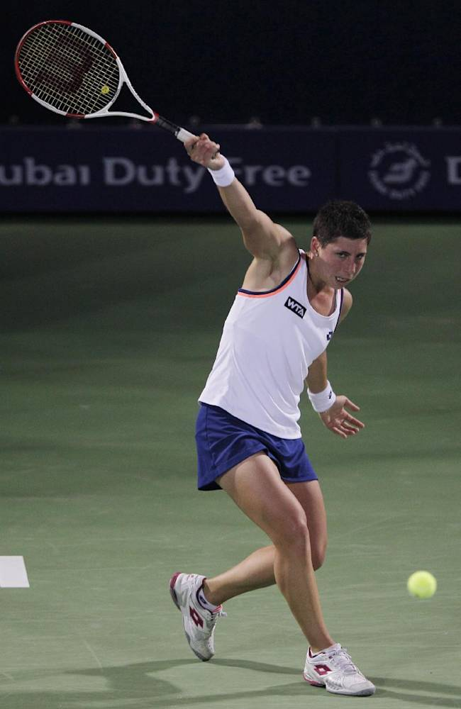 Carla Suarez Navarro of Spain returns the ball to Alize Cornet of France during the quarterfinals of the Dubai Duty Free Tennis Championships in Dubai, United Arab Emirates, Thursday, Feb. 20, 2014