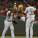 McCutchen's HRs rally Pirates over Reds 6-5 in 11 The Associated Press