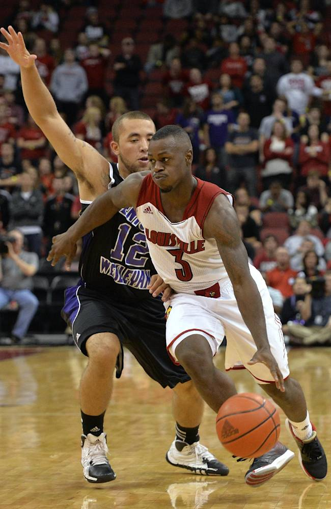 Louisville's Chris Smith, right, drives around the defense of Kentucky Wesleyan's Freddie Young during the second half of an exhibition NCAA college basketball game Tuesday, Oct. 29, 2013, in Louisville, Ky. Louisville defeated Kentucky Wesleyan 115-67
