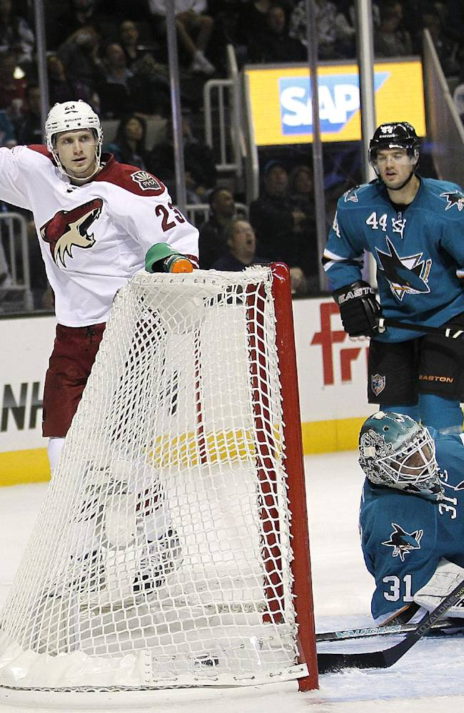 Phoenix Coyotes defenseman Oliver Ekman-Larsson (23) reacts after scoring a goal against San Jose Sharks goalie Antti Niemi (31) during the second period an NHL hockey game in San Jose, Calif., Saturday, Oct. 5, 2013