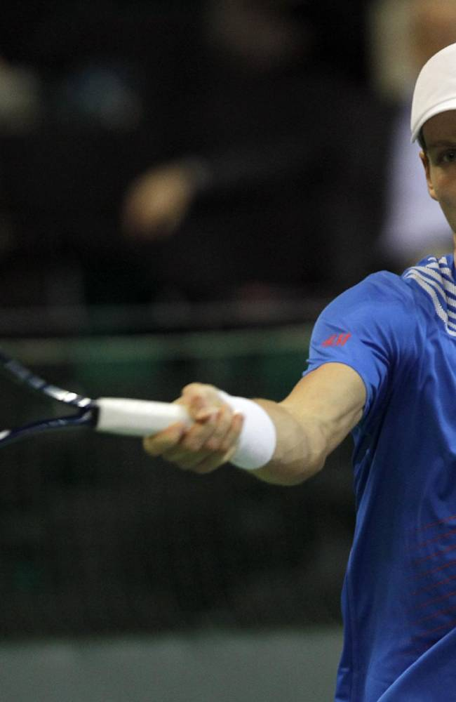 Czech Republic's Tomas Berdych returns a ball to Dusan Lajovic of Serbia during their Davis Cup finals tennis singles match in Belgrade, Serbia, Friday, Nov. 15, 2013