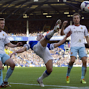 Everton's Leon Osman, centre, clears the ball away from West Ham United's Mark Noble, right, and Matthew Taylor during their English Premier League soccer match at Goodison Park Stadium, Liverpool, England, Saturday March 1, 2014