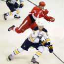 Detroit Red Wings defenseman Brendan Smith (2), top, tries to leap past Buffalo Sabres defenseman Nikita Zadorov (51) of Russia during the second period of an NHL hockey game at Joe Louis Arena in Detroit, Sunday, Jan. 18, 2015 The Associated Press