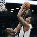 Brooklyn Nets' Andray Blatche, right, is fouled by Charlotte Bobcats' Bismack Biyombo during the second quarter of an NBA basketball game Wednesday, March 19, 2014, at Barclay's Center in New York The Associated Press