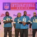 Detroit Lions wide receiver Calvin Johnson, second right, speaks to the crowds, accompanied by fellow Lions players during the NFL Fan Rally in Trafalgar Square, London, England, Saturday, Oct. 25, 2014. The Atlanta Falcons will play the Detroit Lions in
