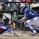 CORRECTS SPELLING OF SURPRISE - Los Angeles Dodgers' Chone Figgins is tagged out by Kansas City Royals catcher Brett Hayes during the third inning of an exhibition baseball game Tuesday, March 11, 2014, in Surprise, Ariz. (AP Photo/Darron Cummings)