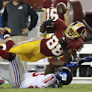 Washington Redskins wide receiver Pierre Garcon (88) tries to recover an incomplete pass broken up by New York Giants cornerback Prince Amukamara, bottom, during the second half of an NFL football game in Landover, Md., Thursday, Sept. 25, 2014. The Asso