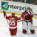 Detroit Red Wings defenseman Niklas Kronwall (55), of Sweden, celebrates with goalie Jimmy Howard (35) after defeating the Chicago Blackhawks 2-0 in Game 4 of the Western Conference semifinals in the NHL hockey Stanley Cup playoffs in Detroit, Thursday, May 23, 2013. (AP Photo/Paul Sancya)