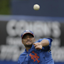 New York Mets starting pitcher Johan Santana throws while working out before an exhibition spring training baseball game Detroit Tigers, Friday, March 1, 2013, in Port St. Lucie, Fla The Associated Press
