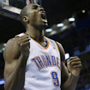 Oklahoma City Thunder forward Serge Ibaka (9) shouts after scoring a basket and being awarded a foul shot in the fourth quarter of an NBA basketball game against the Minnesota Timberwolves in Oklahoma City, Sunday, Dec. 1, 2013. Oklahoma City won 113-103