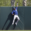 Toronto Blue Jays right fielder Moises Sierra reaches for but misses a home run hit by Houston Astros' Jason Castro during the sixth inning of a spring training baseball game in Kissimmee, Fla., Sunday, March 9, 2014 The Associated Press