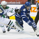 Toronto Maple Leafs' Joffrey Lupul (19) scores his team's fourth goal as Dallas Stars goaltender Karl Lehtonen and Alex Goligoski defend during the second period of an NHL hockey game, Tuesday, Dec. 2, 2014 in Toronto The Associated Press