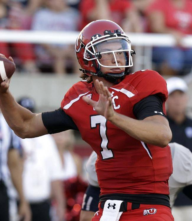 In this Aug. 29, 2013, file photo, Utah's Travis Wilson throws a pass against Utah State during an NCAA college football game in Salt Lake City. On Saturday, Utah hosts Oregon State, a team that has struggled to find its offense after the first two games of the season