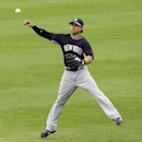 New York Yankees second baseman Brian Roberts throws out Philadelphia Phillies' John Mayberry Jr. at first base during the third inning of an exhibition baseball game Thursday, March 6, 2014, in Clearwater, Fla The Associated Press