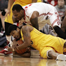 Ohio State's Deshaun Thomas, top, fights for the ball with Minnesota's Maverick Ahanmisi during the first half of an NCAA college basketball game, Wednesday, Feb. 20, 2013, in Columbus, Ohio. (AP Photo/Mike Munden)