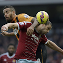 West Ham's Andy Carroll, right, competes for the ball with Hull City's Tom Huddlestone during the English Premier League soccer match between West Ham and Hull City at Upton Park stadium in London, Sunday, Jan. 18, 2015