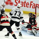 Los Angeles Kings' Trevor Lewis (22) scores on Ottawa Senators goaltender Craig Anderson (41) as Kings' Tyler Toffoli (73) and Senators' Kyle Turris (7) look on during the third period of an NHL hockey game, Thursday, Dec. 11, 2014 in Ottawa The Associate