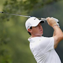 Northern Ireland's Rory McIlroy watches his shot from the 15th tee during a practice round for the 2013 PGA Championship golf tournament at Oak Hill Country Club in Rochester, New York August 7, 2013. REUTERS/Jeff Haynes