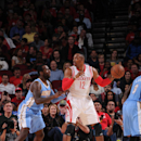 HOUSTON, TX - DECEMBER 13: Dwight Howard #12 of the Houston Rockets handles the ball against the Denver Nuggets on December 13, 2014 at the Toyota Center in Houston, Texas. (Photo by Bill Baptist/NBAE via Getty Images)