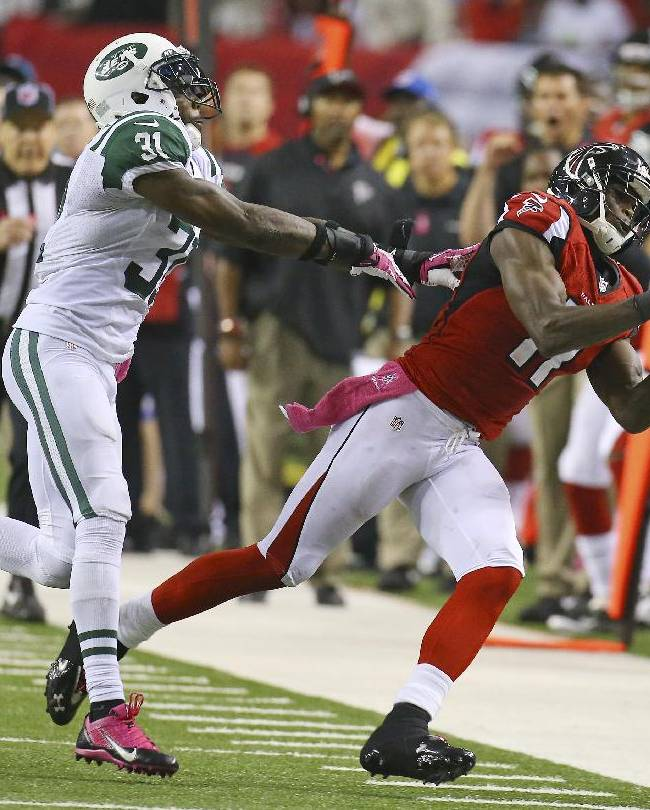 Atlanta Falcons wide receiver Julio Jones can't hold on to a pass as he is hit by New York Jets cornerback Antonio Cromartie during the second half of an NFL football game Monday, Oct. 7, 2013, in Atlanta. (AP photo/Atlanta Journal Constitution, Curtis Compton)