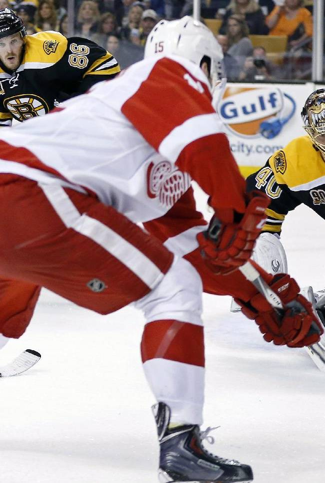 Detroit Red Wings' Riley Sheahan (15) readies a shot on Boston Bruins' Tuukka Rask (40) during the first period in Game 5 in the first round of the NHL hockey Stanley Cup playoffs  in Boston, Saturday, April 26, 2014