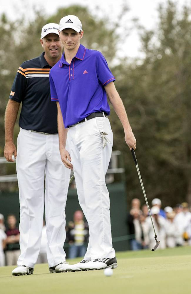 Stewart Cink and his son Connor Cink discuss strategy on the 18th green during the Father-Son Challenge at the Ritz-Carlton Golf Club in Orlando, Fla., Sunday, Dec. 15, 2013