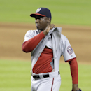 Washington Nationals relief pitcher Rafael Soriano pulls on his shirt after the Nationals defeated the Miami Marlins 6-3 in a baseball game, Wednesday, April 16, 2014, in Miami The Associated Press