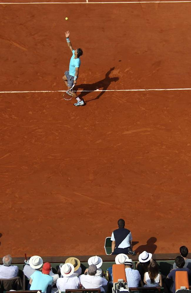 Spain's Rafael Nadal serves the ball to Serbia's Novak Djokovic during their final match of  the French Open tennis tournament at the Roland Garros stadium, in Paris, France, Sunday, June 8, 2014