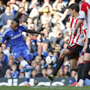 Chelsea's Samuel Eto'o, left, shoots the ball during an English Premier League soccer match against Sunderland at the Stamford Bridge ground in London, Saturday, April 19, 2014