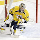 Nashville Predators goalie Pekka Rinne, of Finland, blocks a shot against the Edmonton Oilers in the first period of an NHL hockey game Thursday, Nov. 27, 2014, in Nashville, Tenn. Rinne blocked 37 shots as the Predators won 1-0 in overtime The Associated
