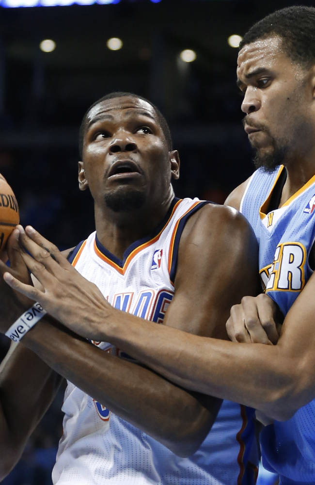 Oklahoma City Thunder forward Kevin Durant, left, drives around Denver Nuggets center JaVale McGee during the first quarter of a preseason NBA basketball game in Oklahoma City, Tuesday, Oct. 15, 2013