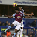 Queens Park Rangers' Brazilian player Sandro, right, and Aston Villa's Carlos Sanchez of Colombia, clash in the air during their English Premier League soccer match at Loftus Road in London, Monday Oct. 27, 2014. (AP Photo / John Walton, PA)