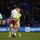 Aston Villa's U.S. goalkeeper Brad Guzan, center right, celebrates their 1-0 victory with his teammate Ciaran Clark after the English Premier League soccer match between Crystal Palace and Aston Villa at Selhurst Park stadium in London, Tuesday, Dec. 2, 2