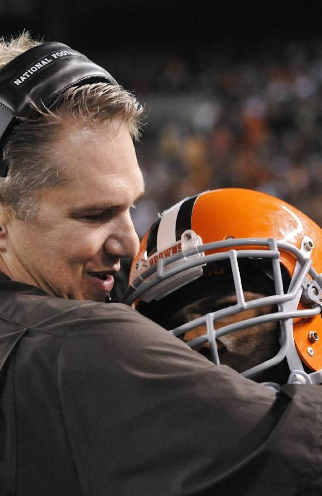 Cleveland Browns coach Rob Chudzinski hugs strong safety T.J. Ward after Ward returned an interception for a touchdown in the fourth quarter of an NFL football game against the Buffalo Bills on Thursday, Oct. 3, 2013, in Cleveland. The Browns won 37-24