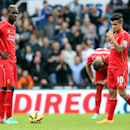 Liverpool's Mario Balotelli, left, and Phillippe Coutinho, right, stand dejected as Newcastle United's Ayoze Perez celebrates his goal during their English Premier League soccer match at St James' Park, Newcastle, England, Saturday, Nov. 1, 2014