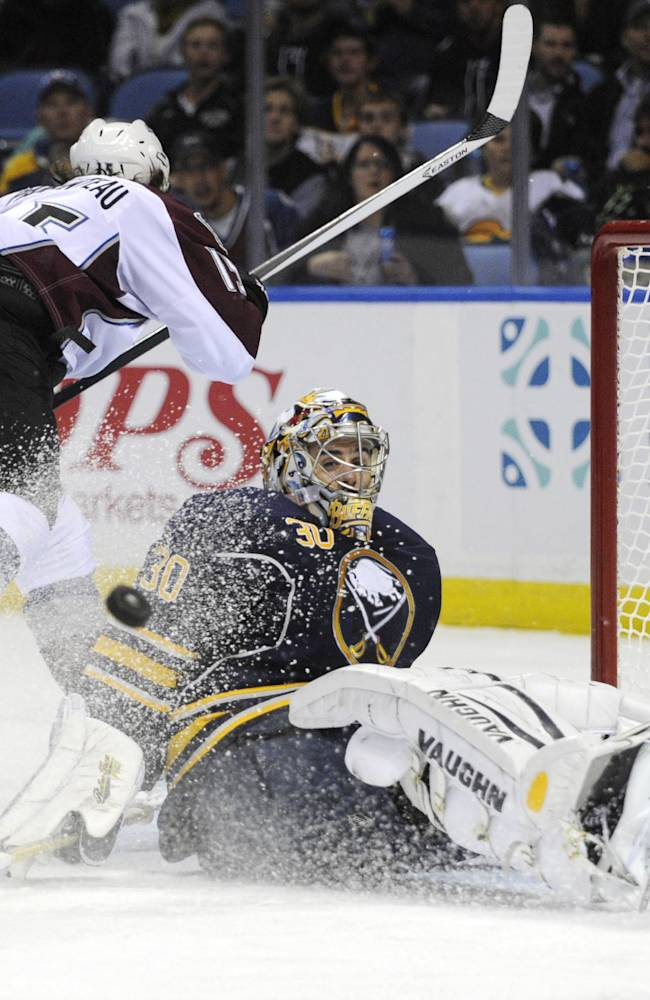 Colorado Avalanche PA Parenteau (15) is stopped by Buffalo Sabres goaltender Ryan Miller (30) during the second period of an NHL hockey game in Buffalo, N.Y., Saturday, Oct. 19, 2013