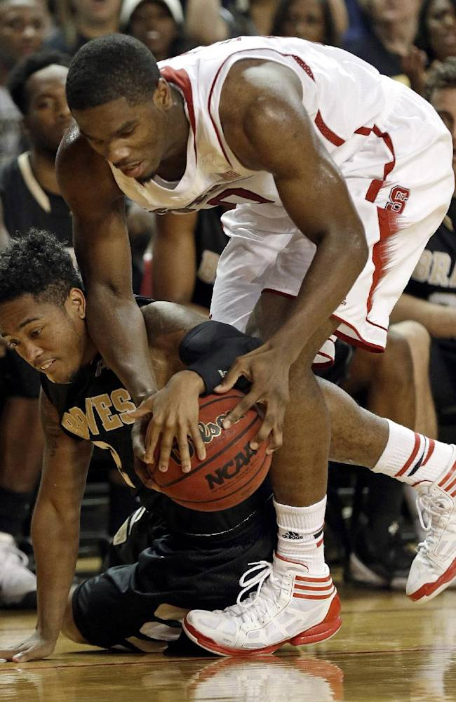 North Carolina State's Lennard Freeman, right, and UNC Pembroke's Alex Bradley struggle for possession of the ball during the second half of an exhibition NCAA college basketball game in Raleigh, N.C., Wednesday, Oct. 30, 2013. North Carolina State won 96-85
