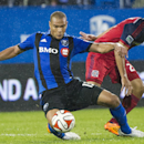 Montreal Impact's Matteo Ferrari, left, and Chicago Fire's Quincy Amarikwa vie for the ball during the second half of an MLS soccer game Saturday, Aug. 16, 2014, in Montreal The Associated Press