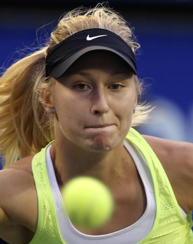 Daria Gavrilova of Russia watches the ball while playing against Carla Suarez Navarro of Spain during their second round match of the Pan Pacific Open Tennis tournament in Tokyo, Thursday, Sept. 18, 2014