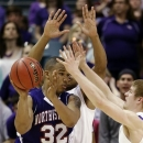 Northwestern State's DeQuan Hicks (32) looks to pass the ball as Stephen F. Austin's Taylor Smith, rear, and Thomas Walkup, right, defend during the first half of the Southland Conference NCAA college championship basketball game, Saturday, March 16, 2013, in Katy, Texas. (AP Photo/David J. Phillip)