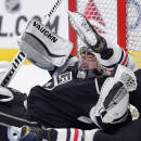 Los Angeles Kings goalie Jonathan Quick gets up after Chicago Blackhawks left wing Brandon Saad collided with him during the first period of an NHL hockey game, Wednesday, Jan. 28, 2015, in Los Angeles. (AP Photo/Mark J. Terrill)